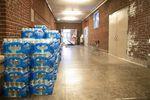 Cases of water bottles line the hallways at Rose City Park school in Portland, Oregon.