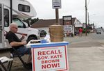"""Michael Cross, leader of the """"Flush Down Kate Brown"""" campaign, collects signatures for a recall petition on Aug. 7, 2019."""