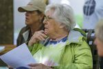 """Lois Keck, right, attends a meeting of the Woodspring Tenants Association. She has been a resident at Woodspring Apartments for 18 years. Deborah Boumann, left, has been a resident for the past nine years and calls her fellow tenants """"her family."""""""