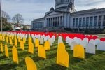 Mock headstones outside the State Capitol mark the number of people who died by suicide in Washington in one year as part of an education event during the 2017 legislative session. Preliminary data shows that suicide deaths in 2020 are about even with where they were a year ago.
