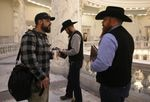 Parker gathers with members of the Real 3%ers Idaho, Nicolas Gatejen and Jordan Marques, before meetings with politicians at the state capitol in Boise on Jan. 24.