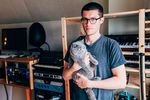 The musician, DJ and producer Andre Allen Anjos, who records under the moniker RAC, in his home studio, with cat.