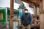 Aldo Medina Martinez, programs director for the Portland Mercado in SE Portland, Ore., poses for a portrait in front of the market's food cart pod on Wednesday, May 20, 2020. Medina Martinez oversees the Mercado's various business programs.