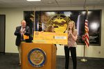 Governor Kate Brown, center, announces Chloe Zinda of McMinnville, right, as the $1 million winner of the Take Your Shot Oregon campaign, July 9, 2021.