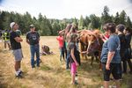 Kobe Norcross, 17, left, talks to John Spence while campers pet and brush Spence's horse, Koda, at Wellness Warrior Camp in Grand Ronde, Ore., Wednesday, June 26, 2019. Spence is trained in equine therapy and leads the connection to horses station at the camp.