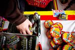 People pick out fireworks at TNT Fireworks stand in Beaverton, Ore., Wednesday, July 3, 2019.
