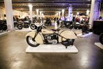 A custom motorcycle sits atop a white display platform at the One Motorcycle Show in Portland, Ore., Friday, Feb. 7, 2020.