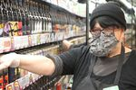 """Patty Beavers wears protective gear at Green Zebra grocery in southeast Portland, """"I'm just grateful that I'm able to work right now. … Just hang in there, be clean, be safe, this will pass. It always has and it will."""""""