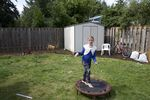 AndaKiss shows off the exercise trampoline in the backyard of the new house.