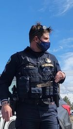 """A submitted photo of Cpl. Joshua Spano carrying a """"Molon Labe"""" keychain while making an arrest in Bend on May 1, 2021."""
