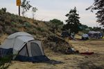 When word spread that Bend police would clear campers from Emerson Avenue in June, more tents appeared along Colorado Avenue and U.S. Highway 97. Fearing another removal, campers and volunteers worked to clear weeds and debris on July 27, 2021.