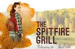 Illustration of a young woman with a stringed musical instrument carried over her shoulder standing in tall grass with trees off in the distance, and the text The Spitfire Grill, February 26-April 18th