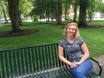 Sharon Raymor sits on a bench on the South Park Blocks, not far from where she currently works for the City of Portland. She spent more than four years in Facilities and Asset Management at Portland Public Schools.