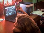 Five-year-old Abby Bucolo attends her kindergarten classes online, weeks after the Almeda Fire destroyed her home.