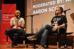 """Joseph Fink (left) and Jeffrey Cranor (right), the creators of the podcast, """"Welcome to Nightvale"""", and authors of the novel """"It Devours!"""", onstage at Wordstock 2017."""