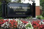 "A sign reads ""Western Oregon University, Founded 1856."""