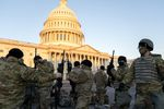 Weapons are distributed to members of the National Guard outside the U.S. Capitol on Wednesday. Security has been increased throughout Washington following the breach of the U.S. Capitol last Wednesday, and leading up to the Presidential inauguration.