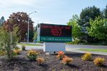 A sign in front of Tigard High School lists every student in the class of 2020.