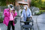 It took three years for Donna Duran, right, 82, to be get an apartment in the senior affordable housing complex at Rosemont Court in North Portland. An outbreak of Legionnaires' Disease at Rosemont has killed one resident and sickened many others, forcing residents like Duran to seek other affordable housing. Her caretaker Shelley Jackson, 71, left, searches her phone to find information on relocation information provided by building owners Northwest Housing Alternatives.