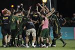 Portland Timbers players celebrate after defeating Orlando City 2-1, during an MLS soccer tournament, Tuesday, Aug. 11, 2020, in Kissimmee, Fla.
