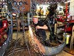 Jud Turner welds together pieces of Veribus.