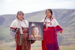 Mildred Quaempts and Merle Kirk hold a portrait of Mavis Kirk-Greeley, who died in 2009 when her boyfriend deliberately hit her with his vehicle on the Warm Springs Indian Reservation. Kirk-Greeley is Quaempts' daughter and Kirk's sister.