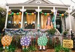 "Across New Orleans, thousands of homes like this one — the ""Queen of Bounce House"" — are decorated for Mardi Gras. People drive from house-to-house because the city canceled parades due to COVID."
