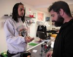 Rose City Vapors owner Marcus Nettles (left) works with customer Matt Menard at his shop in Northeast Portland. Nettles said Oregon's flavored vaping ban will cost him business to the internet.