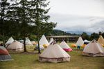 The powwow arbor sits beyond a small village of tipis and tents at Wellness Warrior Camp.