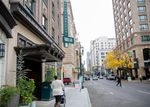 A woman walks past the Woodlark Building, home of the Woodlark Hotel, on Tuesday, Oct. 15, 2019, in downtown Portland, Ore. The hotel is at the corner of Southwest Alder Street and Southwest Park Avenue on the western side of the downtown Clean & Safe district.