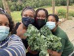 Shantae Johnson (left) snaps a selfie with the farm crew at Mudbone Grown's Feed 'Em Freedom Farm