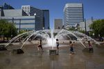 Children play in the fountain at the Portland Waterfront as the temperature rises to more than 100 degrees Fahrenheit.