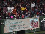 Thorns fans at Providence Park in Portland hold signs in dismay over the club's handling of sexual misconduct allegations.