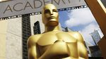 A close-up image of a larger-than-human-scale statue of the Academy Awards statuette.