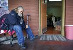 Eric Hanson sits outside of his apartment at NE Sandy Studios in Northeast Portland, where he has lived for the past five years on March 29, 2021. Hanson's apartment is packed and in two days he must leave the apartment complex, a supportive housing for formerly homeless veterans, though he has not secured a place to live.