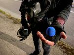 A protester shows an impact munition that police fired at demonstrators during a protest on April 12, 2021.