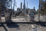 A service station that was destroyed by a wildfire is shown Tuesday, Sept. 8, 2020, in Malden, Wash. High winds kicked up wildfires across the Pacific Northwest on Monday and Tuesday, burning hundreds of thousands of acres and mostly destroying the small town of Malden in eastern Washington state. (AP Photo/Jed Conklin)