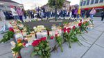 Flowers and candles are placed at a memorial after a man killed several people in Kongsberg, Norway.
