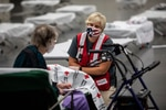 Emily Girard of the American Red Cross speaks with Sue Barnes at an American Red Cross shelter at the Oregon Convention Center in Portland, Ore., on Monday, Sept. 14, 2020, after Barnes evacuated because of wildfires burning throughout the region.
