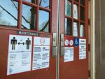 Portland Public Schools have been closed to in-person learning since March 2020. Signs on the front doors at Sabin Elementary School lay out COVID-19 health procedures for the anticipated return of students.