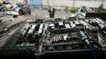Basel Action Network director Jim Puckett, documenting his findings in Hong Kong junkyard where electronic waste is being dismantled.