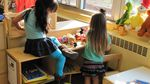 Preschoolers working together on a puzzle (file photo).