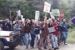 """Activists march in protest of the """"salvage logging rider"""" that was passed by Congress and signed into law by President Clinton in 1995. It released timber sales for logging and helped undermine Clinton's Northwest Forest Plan."""