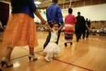Congregants kick off the evening celebration with a traditional Tongan march around the auditorium at The Church of Jesus Christ of Latter-day Saints Rose City Ward in Portland