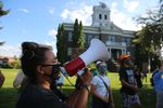 Josie Stanfield leads a chant outside the Crook County courthouse on August 15, 2020.