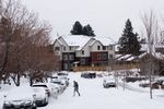 A person walks to their car in the Mountain View neighborhood of Bend, Ore., Friday, Feb. 12, 2021, after a day's snowfall.