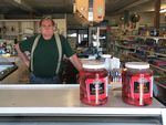 Clint Barber has owned Rhodes Supply since 1988. He says people buy a lot more bottled water these days than they used to — and a lot less soda pop.