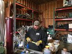 Commercial fisherman Clint Funderburg works a side job building refrigeration for one of many fishing boats that are stuck at the dock during the coronavirus pandemic.