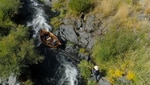"""Randy Dersham """"lines"""" his wooden driftboat down the Fish Ladder on the Rogue River."""