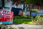 Several yard signs for local candidates are displayed in front of a house in the Southeast Portland, Ore., neighborhood of Brooklyn on Monday, April 20, 2020.